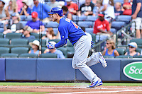 Chicago Cubs starting pitcher Jake Arrieta (49) runs to first during a game against the Atlanta Braves at Turner Field on June 11, 2016 in Atlanta, Georgia. The Cubs defeated the Braves 8-2. (Tony Farlow/Four Seam Images)