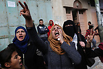 Relatives of Palestinian Amal el-Tramsi, 43, who was shot dead by Israeli troops during clashes on Israel-Gaza border, mourn during her funeral in Gaza city, on January 12, 2019. Photo by Ashraf Amra