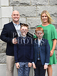 Max Peters who received first holy communion in St. Cianan's church Duleek pictured with parents Sean and Grainne and brother Zach.  Photo:Colin Bell/pressphotos.ie