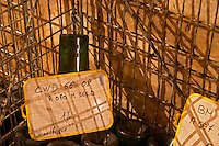 The Vinotheque (wine library) with small numbers of older bottles stacked stored upside down on their heads. The oldest bottle in the collection: a single bottle of the 1966 vintage Cuvee William Deutz at Champagne Deutz in Ay, Vallee de la Marne, Champagne, Marne, Ardennes, France