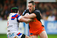 Picture by Alex Whitehead/SWpix.com - 27/04/2018 - Rugby League - Betfred Super League - Castleford Tigers v Wakefield Trinity - Mend-A-Hose Jungle, Castleford, England - Castleford's Joe Wardle is tackled by Wakefield's Ben Jones-Bishop.
