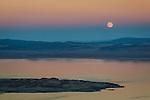 Full moon rising over Mono Lake at sunset, Mono County, Eastern Sierra, California