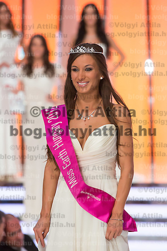 Newly elected Miss Earth Hungary Alexandra Kocsis poses after winning a joint beauty contest in Budapest June 9, 2012.