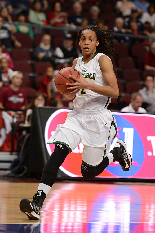 March 6, 2014; Las Vegas, NV, USA; San Francisco Lady Dons guard Taj Winston (2) drives to the basket against the Loyola Marymount Lions during the first half of the WCC Basketball Championships at Orleans Arena.