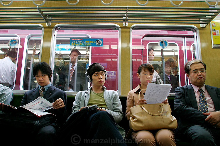 Commuter culture on the Osaka-Kobe subway route in Japan. (Supporting image from the project Hungry Planet: What the World Eats.)