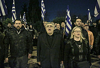 The leader of the party, Nikolaos Michaloliakos (C) joins members of far right group Golden Dawn (Chrysi Avgi) as they march