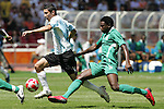 23 August 2008: Angel Di Maria (ARG) (11 white) tries to dribble past Solomon Okoronkwo (NGA) (11 green). Argentina's Men's National Team defeated Nigeria's Men's National Team 1-0 at the National Stadium in Beijing, China in the Gold Medal match in the Men's Olympic Football tournament.