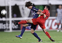 WASHINGTON, DC - July 28, 2012:  Lewis Neal (240 of DC United pokes the ball away from Adrien Rabiot (31) of PSG (Paris Saint-Germain) in an international friendly match at RFK Stadium in Washington DC on July 28. The game ended in a 1-1 tie.