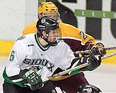 Ryan Stoa, Zach Jones - The University of Minnesota Golden Gophers defeated the University of North Dakota Fighting Sioux 4-3 on Friday, December 9, 2005, at Ralph Engelstad Arena in Grand Forks, North Dakota.