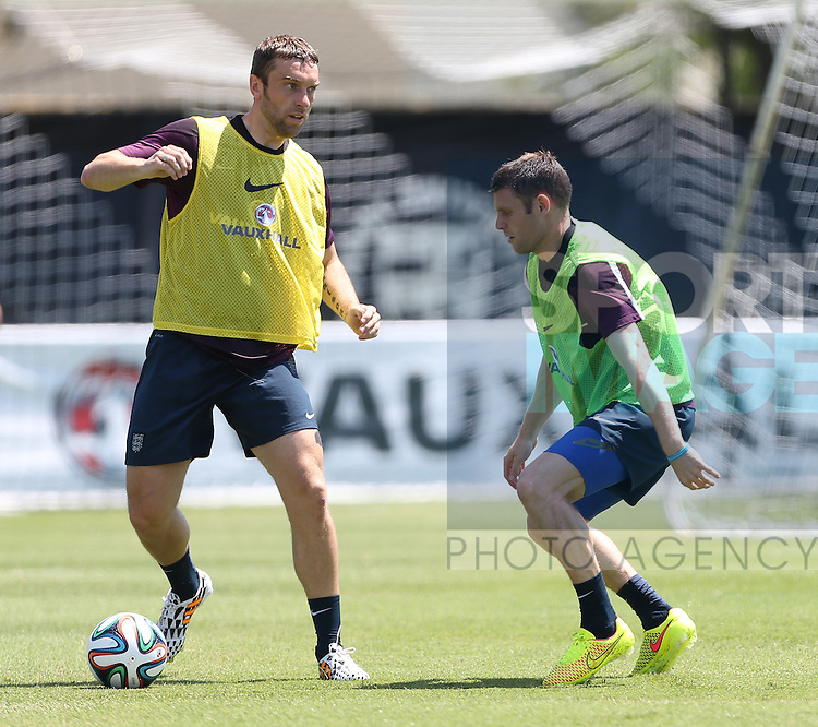 England's Rickie Lambert tussles with James Milner during training<br /> <br /> England Training &amp; Press Conference  - Barry University - Miami - USA - 06/06/2014  - Pic David Klein/Sportimage