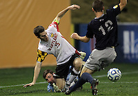 HOOVER, AL - DECEMBER 07, 2012:  \Patrick Mullins (15) of the University of Maryland gets between Tomas Gomez (1) and Keegan Rosenberry (12) of Georgetown University during an NCAA 2012 Men's College Cup semi-final match, at Regents Park, in Hoover , AL, on Friday, December 07, 2012. The game ended in a 4-4 tie, after overtime Georgetown won on penalty kicks.