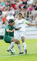 Daniela Alves (green) challenged by Shannon Boxx...Saint Louis Athletica and LA Sol, played to a 0-0 tie at Robert Hermann Stadium in St Louis, MO. April 25 2009.