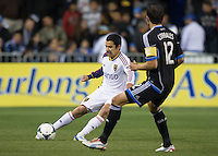 March 3rd, 2013: Tony Beltran tries to control the ball away from Ramiro Corrales during a game at Buck Shaw Stadium, Santa Clara, Ca.  Salt Lake Real defeated San Jose Earthquakes