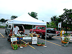 Selling agricultural produce at weekend farmers market
