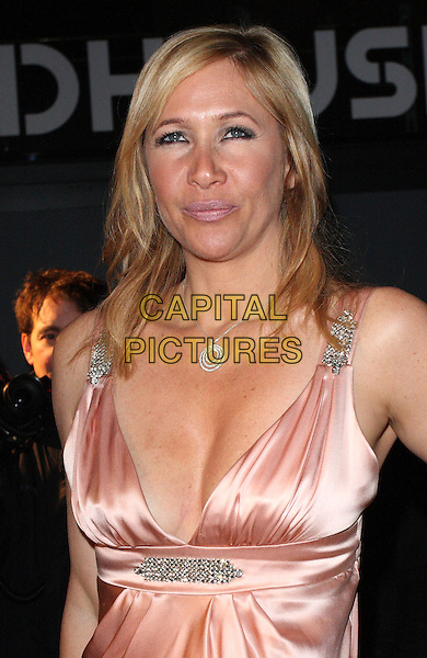 TANIA BRYER .Attending The Love Ball during London Fashion Week, the Roundhouse, Chalk Farm Road, London, England..February 23rd 2010.LFW arrivals half length peach pink nude sleeveless dress silk satin silver  cleavage low cut tanya .CAP/ROS.©Steve Ross/Capital Pictures.