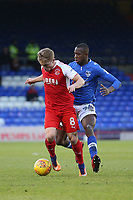 Fleetwood Town's Kyle Dempsey (left) and Oldham Athletic's Ousmane Fane (right) during the Sky Bet League 1 match between Oldham Athletic and Fleetwood Town at Boundary Park, Oldham, England on 26 December 2017. Photo by Juel Miah / PRiME Media Images.