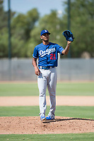 Los Angeles Dodgers relief pitcher Aldry Acosta (21) waits to receive the ball back from the catcher during an Instructional League game against the Milwaukee Brewers at Maryvale Baseball Park on September 24, 2018 in Phoenix, Arizona. (Zachary Lucy/Four Seam Images)