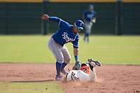 Kansas City Royals second baseman Ricky Aracena (2) applies the tag to Alexander Canario (32) on a stolen base attempt during an Instructional League game against the San Francisco Giants at the Giants Training Complex on October 17, 2017 in Scottsdale, Arizona. (Zachary Lucy/Four Seam Images)