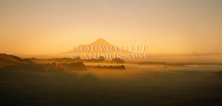 Golden light on Mount Taranaki. Taranaki Region New Zealand.