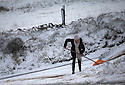 11/12/14<br /> <br /> A woman spreads grit from a road-side supply to clear the narrow lane that leads to her home near Flash after overnight snow fall settles on hills in the Staffordshire Peak District.<br /> <br /> ***ANY UK EDITORIAL PRINT USE WILL ATTRACT A MINIMUM FEE OF £130. THIS IS STRICTLY A MINIMUM. USUAL SPACE-RATES WILL APPLY TO IMAGES THAT WOULD NORMALLY ATTRACT A HIGHER FEE . PRICE FOR WEB USE WILL BE NEGOTIATED SEPARATELY***<br /> <br /> <br /> All Rights Reserved - F Stop Press. www.fstoppress.com. Tel: +44 (0)1335 300098