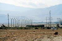 WINDMILLS<br /> Electrical Wind Turbines<br /> Wind farm in Indio, CA<br /> Renewable energy from eolian power<br />  Converts wind energy into electricity.