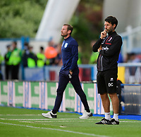 Huddersfield Town manager Jan Siewert, left, and Lincoln City manager Danny Cowley<br /> <br /> Photographer Chris Vaughan/CameraSport<br /> <br /> The Carabao Cup First Round - Huddersfield Town v Lincoln City - Tuesday 13th August 2019 - John Smith's Stadium - Huddersfield<br />  <br /> World Copyright © 2019 CameraSport. All rights reserved. 43 Linden Ave. Countesthorpe. Leicester. England. LE8 5PG - Tel: +44 (0) 116 277 4147 - admin@camerasport.com - www.camerasport.com