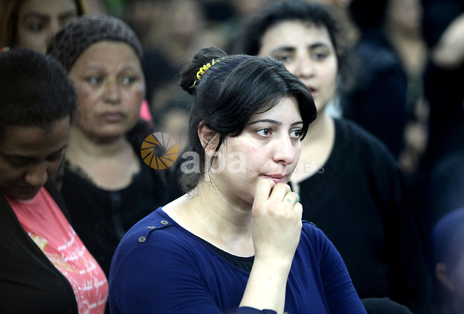 Relatives of the Coptic Christians victims mourn during their funeral at Abu Garnous Cathedral in Minya, some 260 kms south of the capital Cairo, on May 26, 2017. Masked gunmen attacked a bus carrying Coptic Christians on a visit to a monastery south of the Egyptian capital on Friday, killing at least 28 people including children, officials said. Photo by Amr Sayed