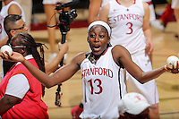 STANFORD, CA - February 27, 2014: Stanford Cardinal's Chiney Ogwumike heads toward her family after Stanford's 83-60 victory over Washington at Maples Pavilion.