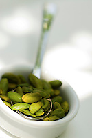 Detail of a small dish full of Bronte pistachios