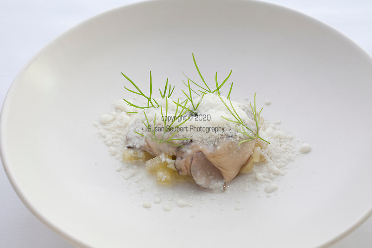 Raw oysters with frozen horseradish cream at Castagna Restaurant in Portland, OR