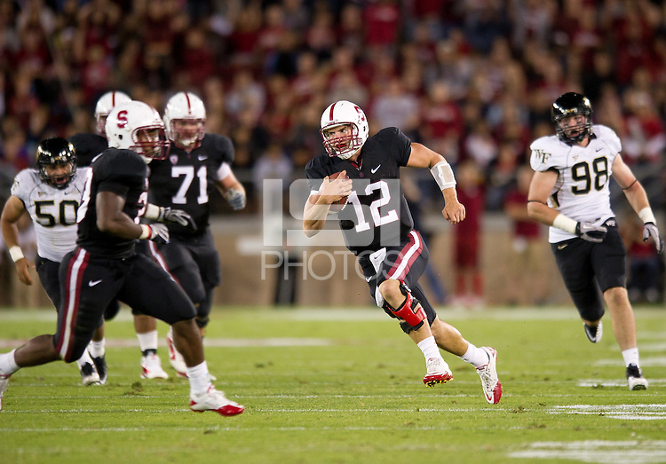 STANFORD, CA - September 18, 2010: Andrew Luck during a football game against Wake Forest at Stanford Stadium in Stanford, California. Stanford won 68-24.