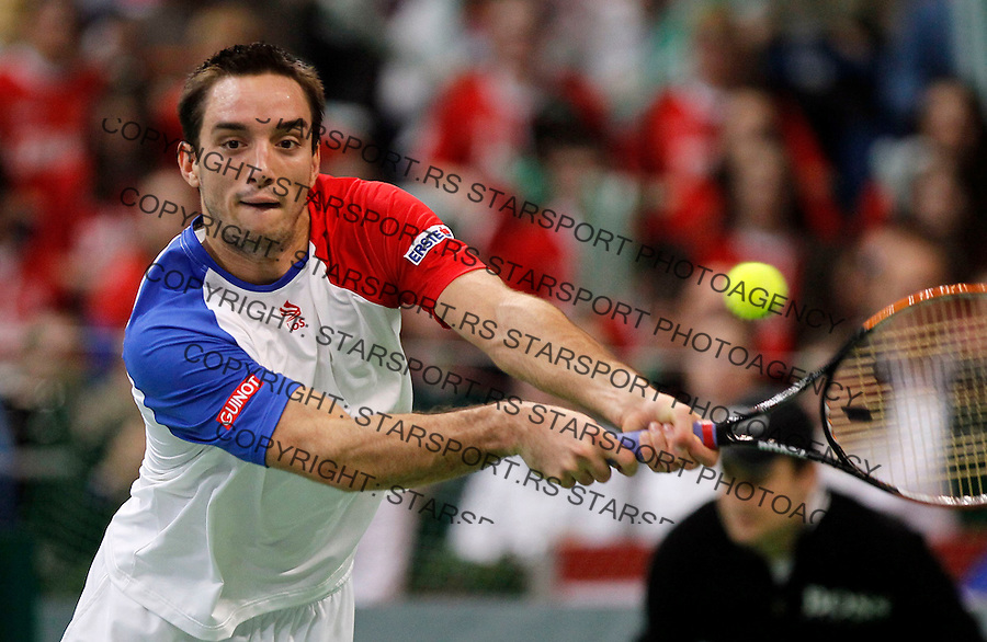 Viktor Troicki of Serbia returns a ball to Michael Llodra of France during their Davis Cup Final match in Belgrade, Serbia, Sunday, Dec.5, 2010..(Srdjan Stevanovic/Starsportphoto ©)