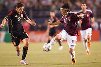 Venezuelan forward Jesus Gomez (10) beats Mexico's Israel Castro moving to the goal. The national teams of Mexico and Venezuela played to a 1-1 draw in an International friendly match at  Qualcomm stadium in San Diego, California on  March 29, 2011...