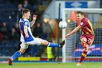 Tony McMahon of Bradford City clears the ball away from Richie Smallwood of Blackburn Rovers during the Sky Bet League 1 match between Blackburn Rovers and Bradford City at Ewood Park, Blackburn, England on 29 March 2018. Photo by Thomas Gadd.