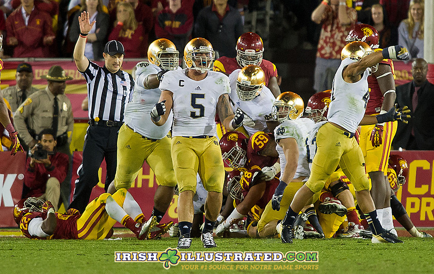 Linebacker Manti Te'o (5) and safety Matthias Farley (41) celebrate stopping USC for a third time on the goal line stand.