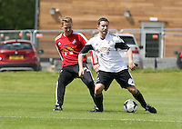 Pictured L-R: Garry Monk against Chris Barney. Tuesday 06 May 2014<br />