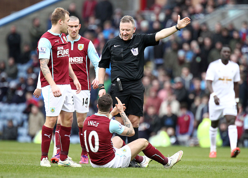 Burnley's Danny Ings reacts to an apparent arm to the head challenge from Swansea City's Ashley Williams as Referee Jonathan Moss awards a free-kick<br /> <br /> Photographer Rich Linley/CameraSport<br /> <br /> Football - Barclays Premiership - Burnley v Swansea City - Friday 27th February 2015 - Turf Moor - Burnley<br /> <br /> &copy; CameraSport - 43 Linden Ave. Countesthorpe. Leicester. England. LE8 5PG - Tel: +44 (0) 116 277 4147 - admin@camerasport.com - www.camerasport.com