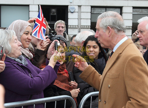 BEDFORDSHIRE, ENGLAND DECEMBER 3 - HRH Prince Charles, Prince of Wales pictured at various locations during his Royal Visit to Bedfordshire. During the day, the Prince visited the Higgins Museum in Bedford before viewing the Christmas Tree Festival at St Pauls Church in the town.<br /> From there he travelled to the village of Tempsford where - after a short service in the parish church - he unveiled a memorial to women agents who flew out of the nearly RAF base during World War 2.<br /> Finally he toured the family run Jordan's Mill just outside Biggleswade, meeting with the owners, staff and local business people, Before driving to his helicopter to leave from the grounds of Biggleswade Town Football Club - December 3rd 2013<br /> CAP/JIL<br /> &copy;Jill Mayhew/Capital Pictures
