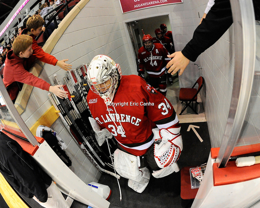 Saint Lawrence Saints goalie Matt Weninger (34) leads the team out of the locker room at the Saint Lawrence vs Boston University NCAA hockey game played at the Agganis Arena, in Boston Massachusetts.  Eric Canha/CSM