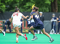 College Park, MD - May 19, 2018: Navy Jenna Collins (44) tries to run past Maryland Terrapins Julia Braig (24) during the quarterfinal game between Navy and Maryland at  Field Hockey and Lacrosse Complex in College Park, MD.  (Photo by Elliott Brown/Media Images International)