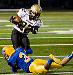 SEYMOUR, CT-112217JS12- Woodland's Matt Mills (22) gets wrapped up by Seymour's Jonathan Dumas (3) during their game Wednesday at Seymour High School. Seymour defeated the Hawks  56-8. Jim Shannon Republican-American
