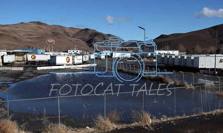 An industrial area in Sparks, Nev., was closed for part of the day Sunday, Dec. 2, 2012, as a heavy, wet storm moved throught the Northern Nevada region. The storm, which deliverd more snow and less rainfall than forecast caused less flooding than expected.  (AP Photo/Cathleen Allison)