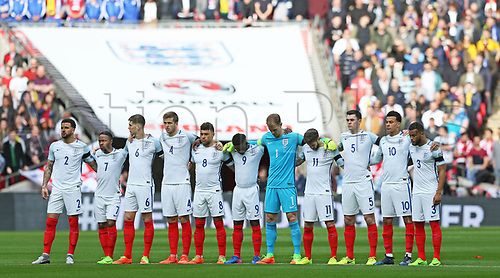 March 26th 2017, Wembley Stadium, London, England; World Cup 2018 Qualification football, England versus Lithuania; England players stand together for a minute silence to remember the deaths in the terrorist attack at Westminster