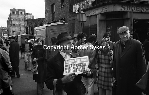 National Front supporter selling National Front News north end of Brick Lane, junction with  Bacon Street, east London. 1970s Uk.  ..