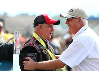 May 17, 2015; Commerce, GA, USA; NHRA funny car driver Tim Wilkerson (left) talking with NHRA official Graham Light after winning the Southern Nationals at Atlanta Dragway. Mandatory Credit: Mark J. Rebilas-USA TODAY Sports