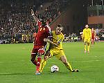 Belgium's Christian Benteke tussles with Wales' James Chester<br /> <br /> - European Qualifier - Belgium vs Wales- Heysel Stadium - Brussels - Belgium - 16th November 2014  - Picture David Klein/Sportimage