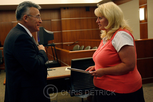 Heidi Nestel talks with Rodwicke Ybarra, Salt Lake County deputy district attorney, at the Third District Court, Tuesday, July 29, 2008. Heidi Nestel, Project Director and Staff Attorney for the Utah Crime Victims Legal Clinic, provides free legal representation to victims of crimes as they go through the criminal justice system..Photo by Chris Detrick/The Salt Lake Tribune.frame #_2CD1132.