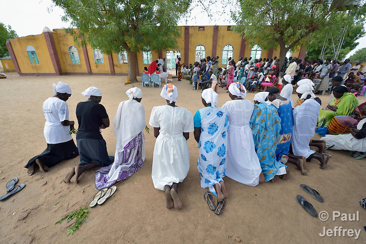 Women kneel during a Palm Sunday Mass at the Catholic Church in Abyei, a contested region along the border between Sudan and South Sudan. Under a 2005 peace agreement, the region was supposed to have a referendum to decide which country it would join, but the two countries have yet to agree on who can vote. In 2011, militias aligned with Khartoum looted and destroyed much of the church and drove out most of the Dinka Ngok residents, pushing them across a river into the town of Agok. Yet more than 40,000 Dinka Ngok have since returned, with support from Caritas South Sudan, which has drilled well, built houses, opened clinics and provided seeds and tools for the returnees. Yet violence has continued, with a March 1 militia attack killing four residents, according to the United Nations.