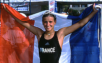 09 NOV 2002 - CANCUN, MEX - Marion Lorblanchet of France celebrates winning the Junior Womens World Triathlon Championships (PHOTO (C) NIGEL FARROW)