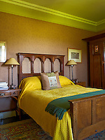 The bed and the wardrobe in this bedroomare both from the Arts & Crafts period